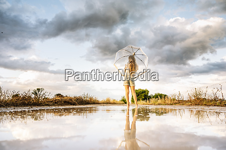 pre adolescent girl with umbrella standing