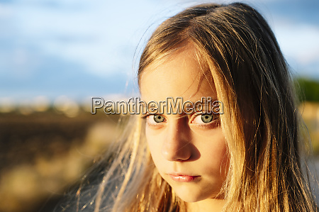 blond girl staring with sunlight on