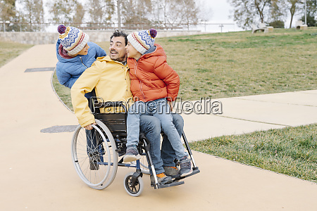 happy man with excited sons riding