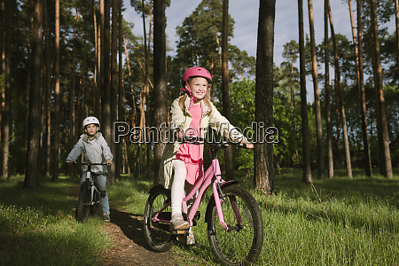 girl and boy riding bicycles on