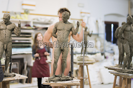 sculptures in the foreground nude model