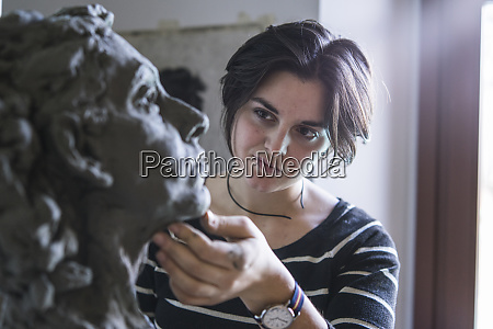 female student looking at bust of