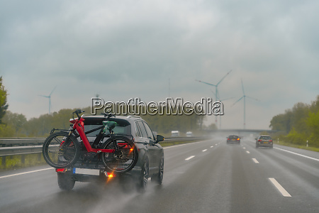motorway during rain car with bike