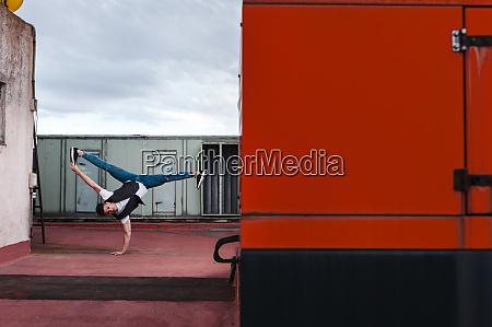 male dancer breakdancing on abandoned building