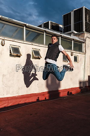 young man jumping on abandoned building