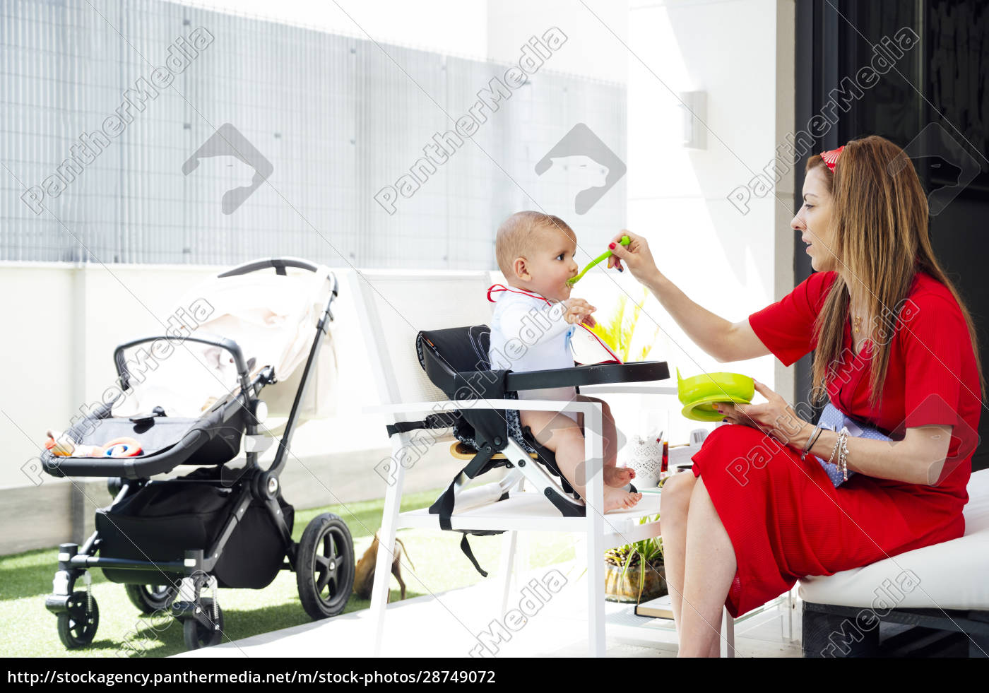 mother, feeding, cute, son, while, sitting - 28749072
