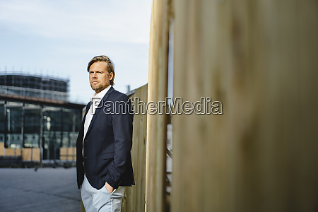 thoughtful businessman standing at a boarding
