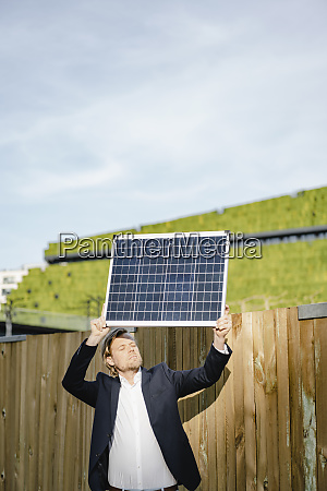 businessman with closed eyes standing at