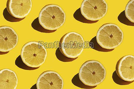 seamless pattern of fresh halved lemons