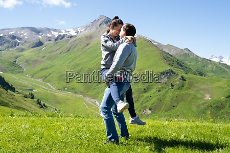 lifting woman in mountains in austria