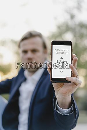 close up of businessman holding smartphone