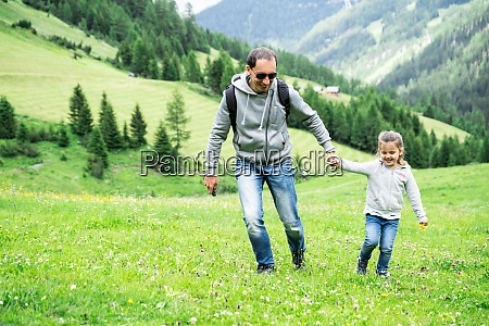 father playing with child girl in
