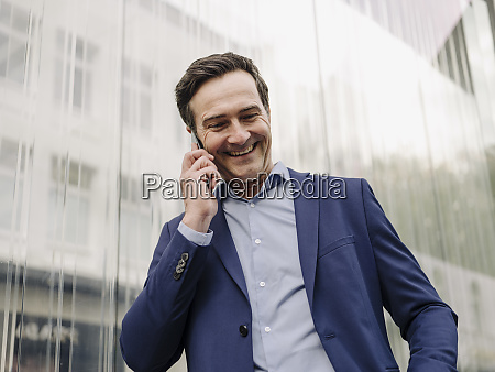 happy mature businessman on the phone