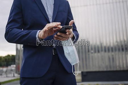 businessman with protective face mask using