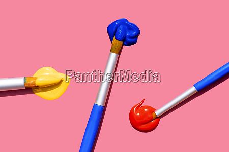 paintbrushes with blue red and yellow