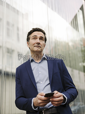 mature businessman with smartphone in the