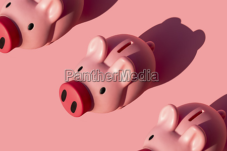 studio shot of three piggy banks