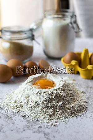 close upof egg yolk in flour