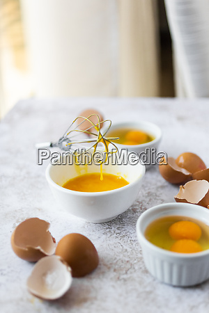 wire whisk eggshells and bowls with