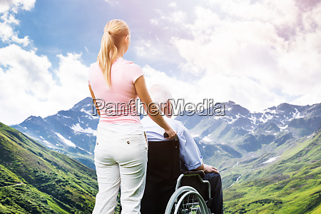 woman transporting disabled old senior