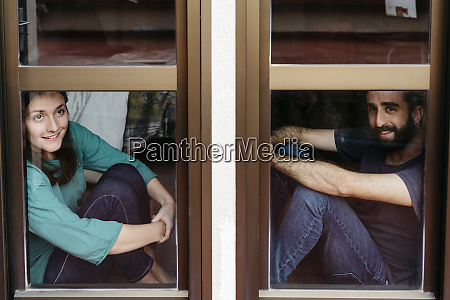 couple looking out the window and