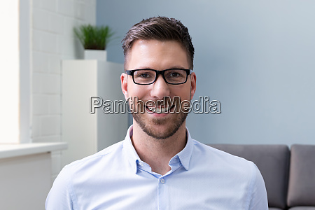 smiling man portrait at workplace