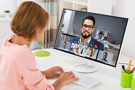 woman videoconferencing on computer