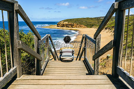man looking at bells beach while