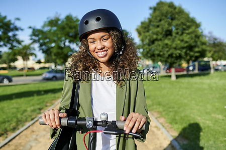 happy young woman standing with electric