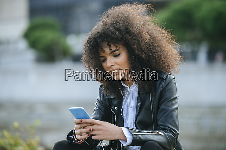young afro woman surfing internet on