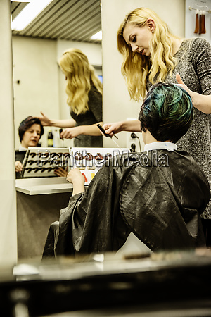 hairdresser showing colour samples to colour