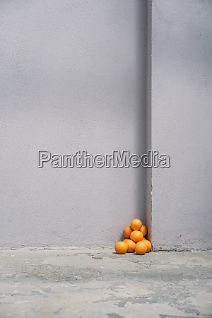 pile of oranges in corner of