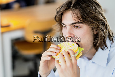 close up of businessman eating sponge