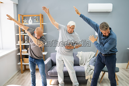 three generation men dancing and exercising