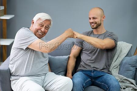 grandpa making fist bump with his