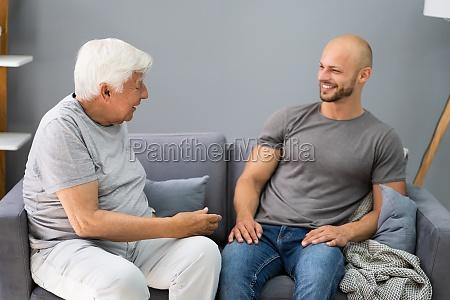grandpa talking to his grandson