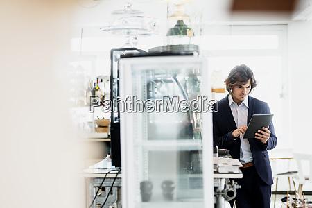 male entrepreneur using digital tablet while