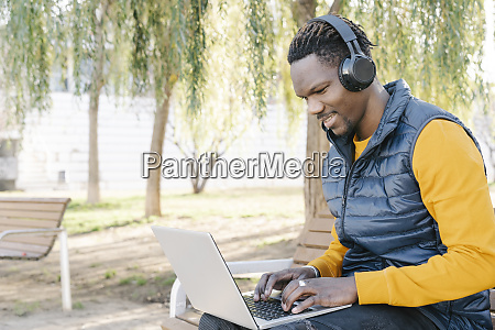 young man with headphones sitting on