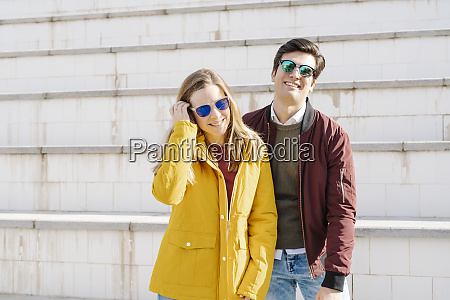 portrait of happy young couple standing