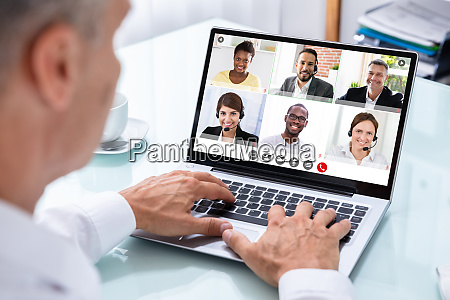 businessman, videoconferencing, with, doctor, on, laptop - 28751386