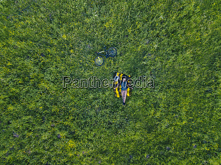 man lying on grass aerial view