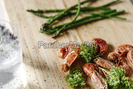 grilled prawns parsley and asparagus on