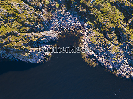 aerial view of rocky shore of