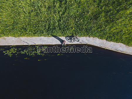 drone shot of mid adult man