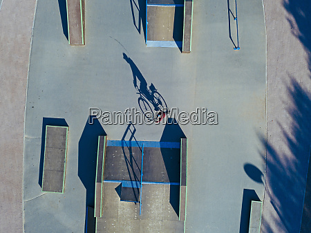 man cycling in skate park aerial