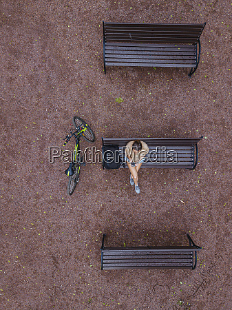 aerial view of woman using smart