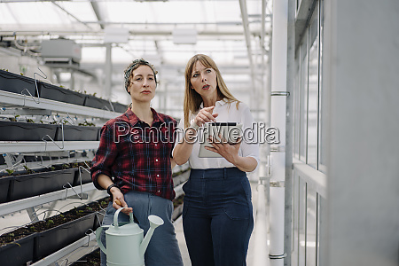 gardener and businesswoman with watering can