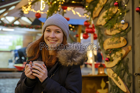 happy woman holding coffee cup at
