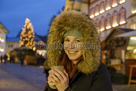 happy woman wearing fur hood while