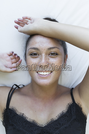 smiling young woman with freckles on